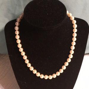 5/$25 Costume jewelry one strand White pearls.